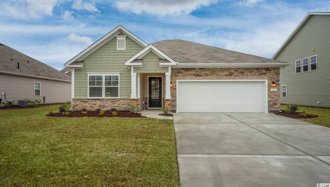 This home is located in popular Surfside Beach. The Retreat at Ocean Commons is a brand new natural gas community offering single level and two-story homes ranging in size from 1613 sq. ft. to 3146 sq. ft. This is the Acadia floor-plan, Elevation C with a stone front. This home comes with a all in package that includes washer, dryer, and refrigerator along with a gas range, microwave, and dishwasher.  This home is located less than 1 mile from the beach and is golf cart friendly! This home comes equipped with hardwood floors, top end granite counter tops, upgraded cabinets, and a covered rear porch! There are additional upgrades that have been added to this home such as the 2-inch faux blinds throughout the whole house and a garage door opener.  Please inquire for details.