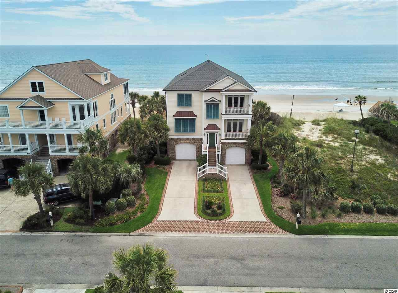 This oceanfront home is located within the gated community of Inlet Point South in Litchfield Beach.  Owners enjoy amenities which include a pool and boat ramp with dock affording boating access to the ocean thru Midway Inlet and adjacent creeks.  This home was custom built with many custom features.  There is a study that could serve as a sixth bedroom.