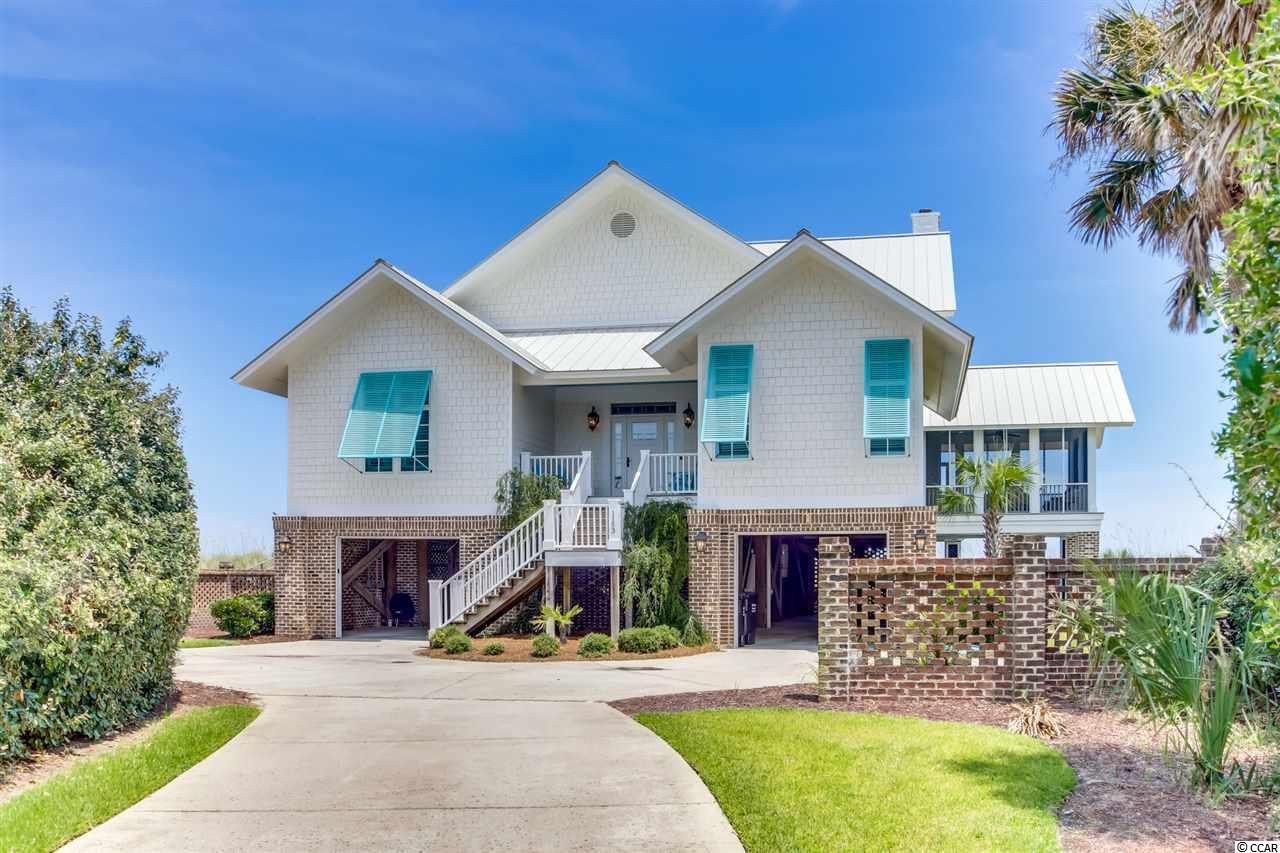AMAZING Oceanfront DeBordieu Colony home that has been well maintained. Enjoy it's high ceilings, gourmet kitchen, luxury furnishings and the VIEW! Perfect family home for DeBordieu Colony beach vacations or a full time residence. Wonderfully decorated and spacious this 5 bedroom home features two king size suites on the lower level as well as an open living/dining and kitchen combination. Wide porch and screened in area on the Oceanside make a perfect place to relax and enjoy the perfect South Carolina weather.  Upstairs features two additional bedrooms with private bathrooms and an additional living room with balcony overlooking the beach. Downstairs there is an den off the living room with a pull out couch that could be used as a 5th bedroom or study. This lovely home also features an Elevator, garage and gorgeous hardwood floors. DeBordieu Colony is truly one of the best kept secrets of The Grand Strand area..the place where families vacation to get away from the hustle and bustle. Surrounded by nature preserves with private beach, award winning Pete Dye golf course, superb dining, Oceanfront community pools, nature trails and much more. Home is being sold furnished.