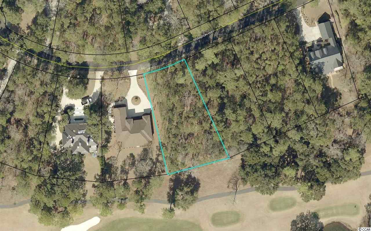 Wooded  home site in ocean front gated community with access to the ocean and North Inlet. Golf course view and just over a half acre parcel will accommodate many custom home plans. Debordieu Colony has optional membership available to beach club, golf, and tennis. Build your home here and enjoy miles of trails, bike paths, and tidal creeks all within a short drive to Pawleys Island or historic Georgetown.