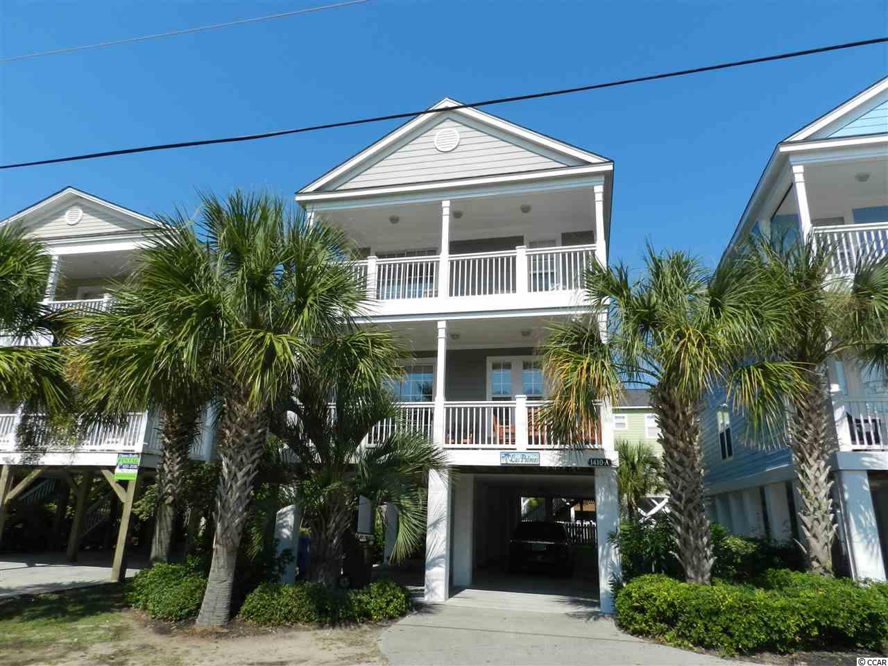 Fantastic 2nd Row Raised Beach House.  Enjoy views of the ocean from two porches; One off the Master and one off the livingroom.  Fully equipped kitchen that features a breakfast bar with an extra seating for six.  This has an awesome floor plan.  Room for the entire family.  You can sit on the back porch and watch everyone in your own private swimming pool.  The pool even can be heated for the cooler nights....Each bedroom has its own bathroom and the master has a jacuzzi tub and with a glass enclosed shower. You will love this home for either a vacation rental, 2nd home or permanent residence....