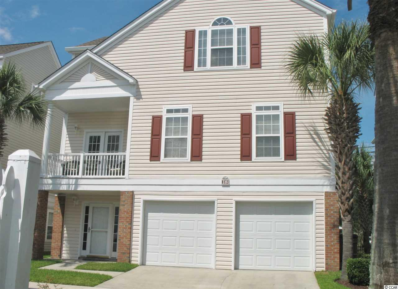 Immaculate and well-maintained home in the Town Of Surfside Beach, SC! This 4 Bedroom, 3.5 Bath home has Beautiful community Pool Views and sits only blocks to the Atlantic Ocean/Beach & Pier! Beautiful raised beach home with enclosed ground level offering a very Spacious 2 car garage with additional storage area for a golf cart, beach toys, bikes and more. Ground level has an additional living space/ 4th Bedroom and full bath that could be used as an office, mother-in-law, kids game area, etc... (has separate entrance on Surfside Drive side of home). Spacious and Open floor plan with Gorgeous Custom Heart Pine hardwood floors in Great room, hallways, on stairs/banister rail and in Master Bedroom (2 coats of protective polyurethane were applied on Heart Pine floors when installed)! Large Laundry Room Upstairs! Master Bedroom has 2 closets one of which is a large walk-in closet. Tons of additional storage closet space throughout home. Home is currently used as a second home/non rental. This house is located in the R2 Residential section and short term rentals are not allowed as per Town of Surfside Beach Ordinance. *Disclaimer: All square footage is approximate and is not guaranteed. Buyer is responsible for verification of measurements, etc...