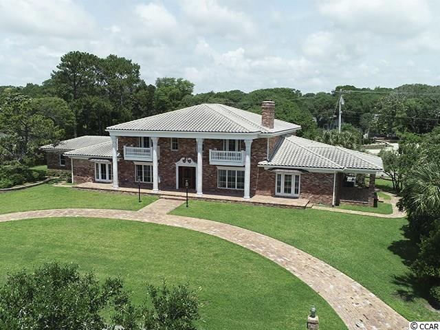 Magnificent all brick, two story home located on 2nd row North Ocean Boulevard in The Dunes Club with beautiful ocean views!! Lot is 0.84 acre and sits 20 feet above sea level. Beautiful marble columns inside and out, Schonbek chandeliers, hard wood floors, Lutron lighting system, 3 fireplaces, elevator, invisible yard fence, jetted tubs and towel warmers in bathrooms, large closets in upstairs bedrooms with pullout drawers, front balconies upstairs and beautiful front, side & rear porches! Listing agent is related to seller.