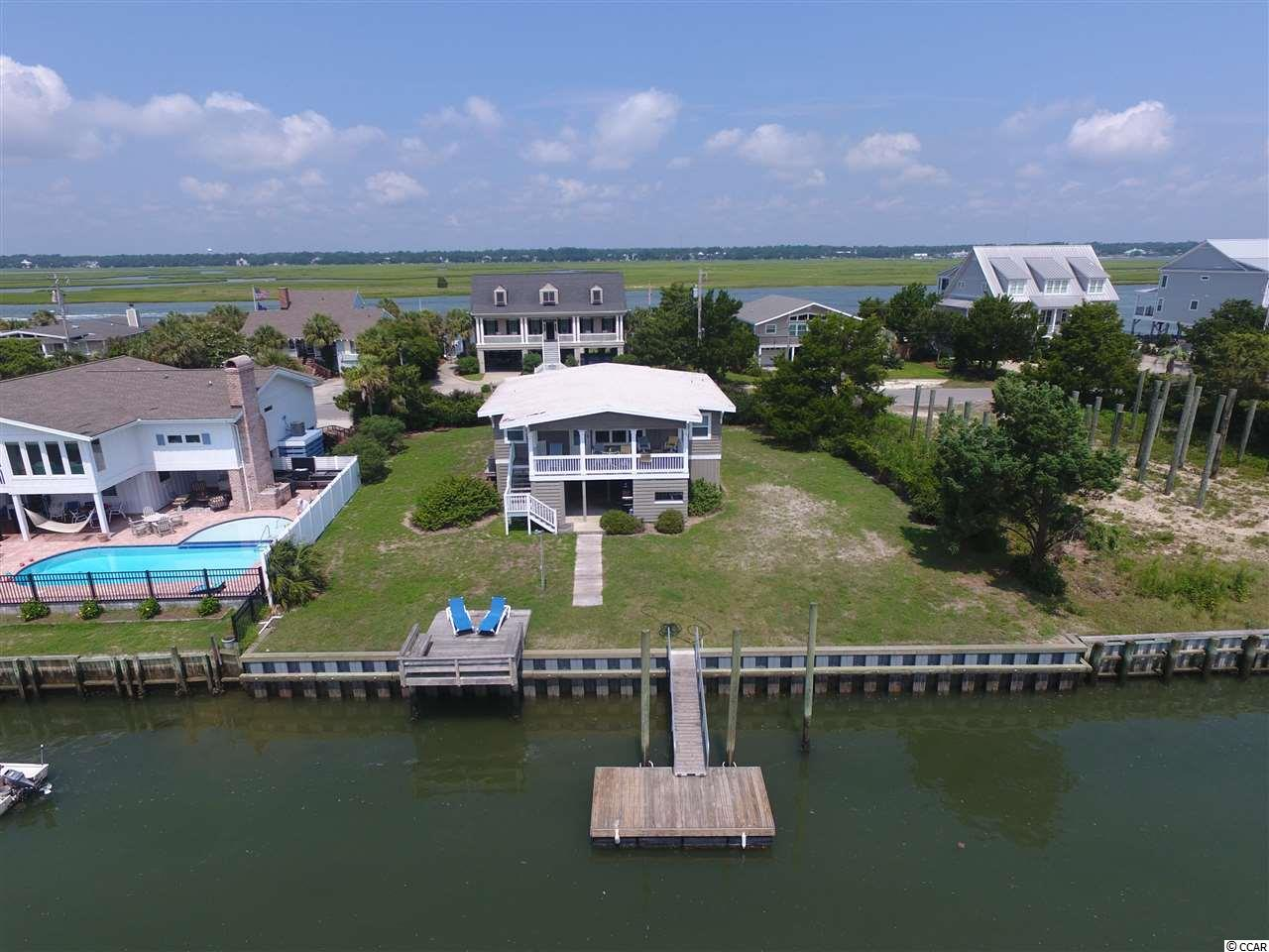Looking for your very own creek house without spending a fortune?  Look no further as 1935 Pompano Drive has a private dock in Oyster Cove located on the South end of Garden City Beach.  This home has a classic beach home design but underwent extensive renovations in late 2015/early 2016.  It's got a great beach home feel with some updates that make it more modern. Contact the listing agent, or your Realtor, for more details or to set up a private showing.