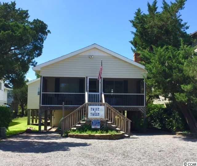 """PRICE REDUCED!! Lowest priced home on Pawleys Island! Consistent RETURN Rentals year after year make this a wonderful opportunity to own a great beach home on the North End of Pawleys Island.  Wide screened porches, to enjoy the lull of the crashing ocean waves as you enjoy your morning coffee or evening cocktails. Just steps to the beach.  Large back deck  for grilling and plenty of parking (8+ cars) in the front yard for friends. Master BR w/ walk-in closet. Big backyard for kids to play. This Perfect location makes The """"Twixt and Tween"""" a favorite summer rental!  Perfect spot on the July 4th parade route. If you enjoy entertaining, this is the house for you- with a kitchen overlooking 2 separate family rooms, and cozy fireplace. A bar area.  Sliding glass doors lead  to the back Deck w/ built-in bench seating for a crowd.  Master BR has sliding glass doors to the back deck too.  Great open floor flow for entertaining, cocktails and grilling. Separate Outdoor shower with dressing area, Big storage room under house for beach toys. Super rental!!! Don't let this prime location home get away!"""