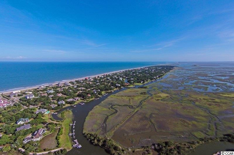 DEBORDIEU PRIVATE GOLF COURSE, WATER MARSH AND BEACHFRONT COMMUNITY - REDUCED PRICE ON THIS EXTRA WIDE GOLF COURSE HOMESITE WITH FABULOUS VIEW OF THE COURSE ALONG THIS PRIVATE PETE DYE GOLF COURSE. CLOSE TO THE BEACH AND JUST A QUICK GOLF CART RIDE TO THE OCEAN CLUBHOUSE, GOLF CLUBHOUSE, TENNIS CLUB AND PRIVATE BOAT LANDING WITH ACCESS TO SOME OF THE BEST FISHING ALONG THE EAST COAST! (121x215x120x215). DEBORDIEU COLONY IS AN OCEANFRONT COMMUNITY LIKE NO OTHER LOCATED JUST SOUTH OF PAWLEYS ISLAND FEATURING PRIVATE GOLF, TENNIS, BEACH AND SALTWATER CREEK ACCESS TO THE OCEAN, A MANNED SECURITY GATE 24/7 SURROUNDED BY HUNDREDS OF ACRES OF WILDLIFE AND NATURE PRESERVES. THIS HOMESITE IS WAITING FOR YOU!  DRASTICALLY REDUCED! MUST GO!