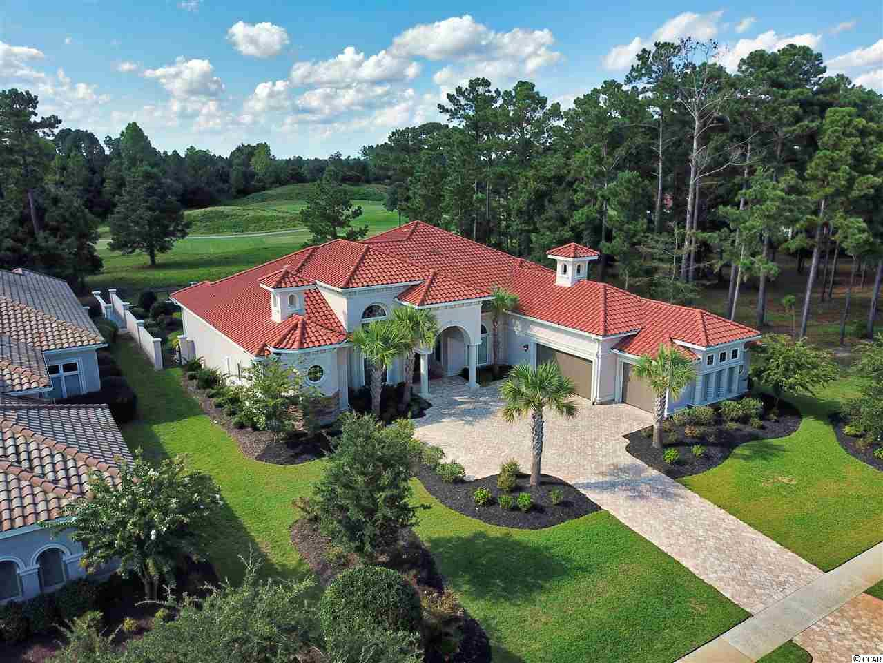 An impeccable home built in 2015 by Omni Home that offers 4 spacious bedrooms, 5.5 baths,out door pool and cookout area and a split 3 car garage.This property sits on 0.46 acre viewing the members club golf course. Inside you will find elegance & sophistication everywhere you look. From the high end granite and appliances in the chefs kitchen, this one you have to see to appreciate the fine details….Grande Dunes. Stretching from the Ocean to the Carolina Bays Preserve, this 2200 acre development is amenity-rich and filled with lifestyle opportunities unrivaled in the market. Owners at Grande Dunes enjoy a 25,000 square foot Ocean Club that boasts exquisite dining, oceanfront pools with food & beverage service, along with meeting rooms and fun activities. Additionally, the community has two 18-hole golf courses, including the area's only truly private course designed by Nick Price, along with several on-site restaurants, deep water marina, Har-tru tennis facility and miles or biking/walking trails!