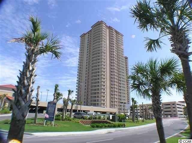 """Truly the """"Penthouse"""" of the first floor!  Imagine having the most unique   floor plan in the most prestigious building on the Grand Strand.  This oceanfront lobby level, professionally decorated unit is the largest 3 bedroom in the building.  With brand new Bosch heating and cooling system, granite floors in the foyer, kitchen and all three bathrooms, wooden cabinetry, granite counter tops throughout, stainless steel appliances, plus a wine captain and trash compactor, hardwood floors in the great room, brand new carpeting in the bedrooms, smooth ceilings, crown molding and so much more.  Since it's lobby level, it also offers 10"""" high ceilings!  Too good to be true?  Be sure to click on the 3-D virtual tour and see for yourself."""