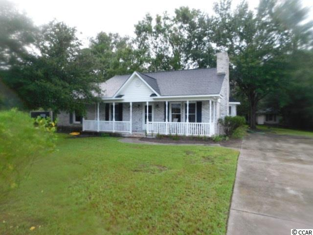 Enjoy country living at its best. This ranch style home boasts 3 bed rooms 2 baths fireplace and formal dining room or breakfast nook. Separate small family room in rear with half bath. Large lot workshop included.