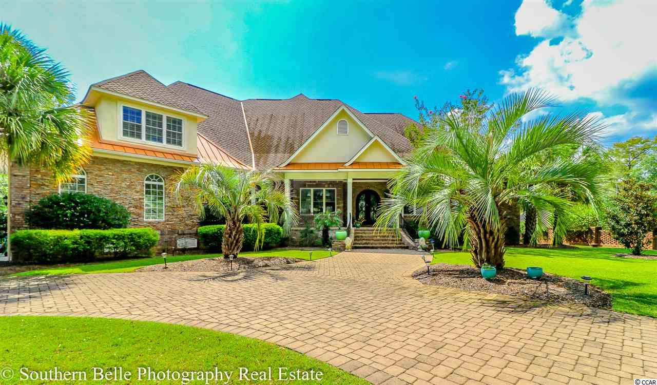 For the discriminating home buyer. This home is stunning inside and out!! 4Bd/5.5 baths, interior features boast double tray and coffer ceilings, distressed walnut flooring, custom iron, granite custom tile work. Eat in gourmet kitchen with custom cabinetry. This beautiful kitchen opens to great room, is the heart of this home. The spiral staircase to the lower level, which offers a family room, mini/gym, wine cellar, tasting area and a gentlemens cigar lounge. Beautiful sundeck and covered porch overlooks Collins Creek's deep water. The private walk way to the gathering area and floating dock are prefect for providing easy access to the Waccamaw River. This is the only equestrian community in Murrells Inlet All measurements and square footage are approximate and not guaranteed. Buyer is responsible for verification of all information pertaining to the property.