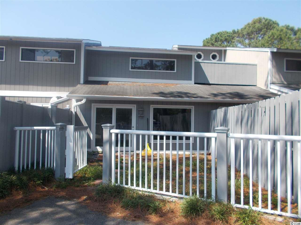 HUGE TWO STORY TOWNHOME WITH VERY LOW FEES. NEW ROOF, ALL NEW STAINLESS STEEL APPLIANCES, PAINT, FLOORING, CABINETS AND GRANITE COUNTERTOPS.  VERY LARGE ROOMS AND CLOSETS WITH TONS OF STORAGE.  EXTREMELY LARGE SECOND FLOOR BALCONY THAT IS PERFECT FOR ENTERTAINING OR RELAXING WITH FAMILY.  FENCED FRONT YARD. GOLF CART RIDE TO THE BEACH, SHOPPING, ENTERTAINMENT AND GOLF.