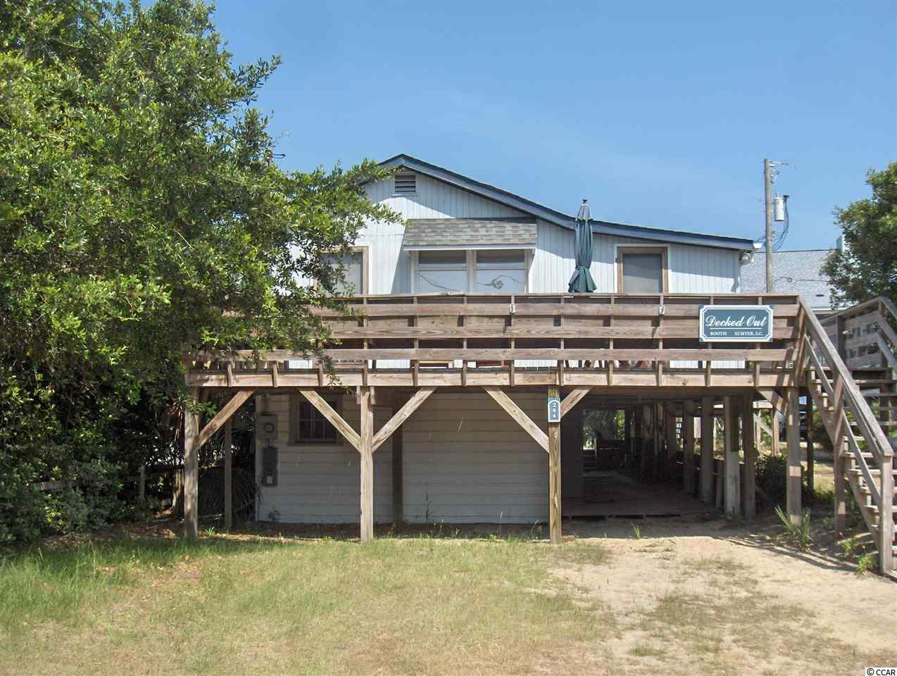 """Decked Out"" is The best off ocean location on Pawleys. On the North End and Just behind oceanfronts homes. This home fronts on both Atlantic Avenue and Pearce Streets for multiple access. Beach access just steps away. No busy street to cross for your darlings. A real old fashioned Pawleys cottage on a nice lot that would allow enlargements and great parking. This home has a grandfathered apartment underneath with comfortable sitting, kitchen and full bath.  Window units supply the a/c and gas wall heaters provide comfort in winter. Huge deck areas and large screened porch. Everything is here and ready for your Pawleys vacation. Enjoy the north end beaches. One block to the creek boat ramp. Comfortable bedrooms share full baths with tub shower combos. Selling furnished with exceptions. See list of items that do not convey in Associated Documents. Measurements are estimated to best of ability. Buyer to confirm all measurements"