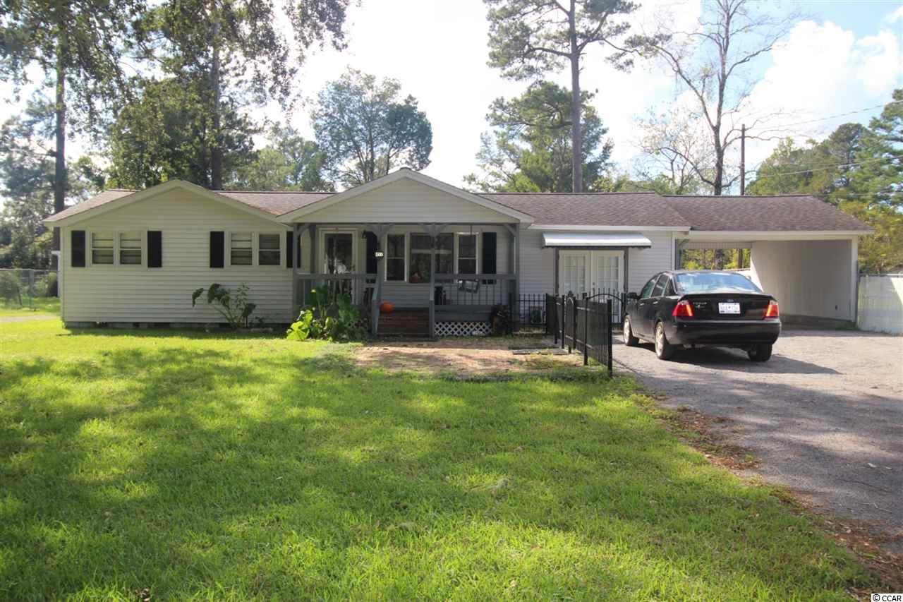 Unique offering for two homes on two parcels under live oaks. Both are currently rented but you could live in one and rent the other or continue as investment property. The main house has two bedrooms and a bath as well as a bonus Carolina room. Front porch , carport, and detached garage. Fenced in back yard. The second home lies under oaks and has 2 bedrooms and a bath.