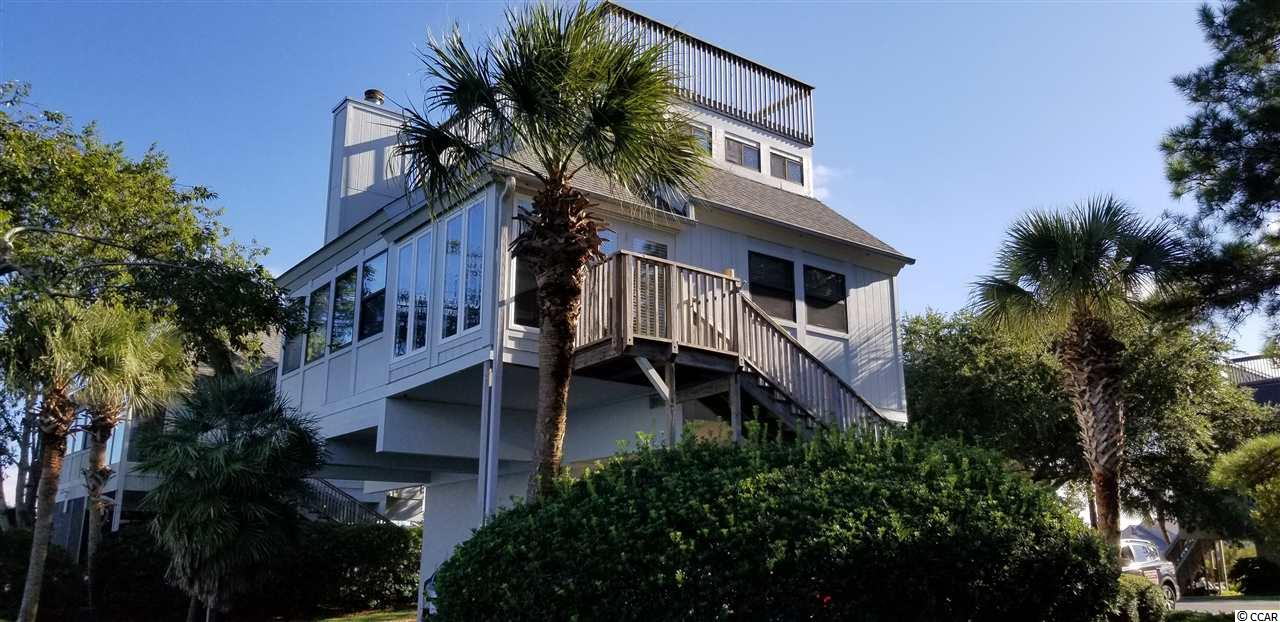 This lovely beach home is located in Litchfield by the Sea in the Pawleys Island/ Litchfield Beaches area.  Three bedrooms, three baths, updated kitchen, living room and lots of outside living areas.  New mattresses and blinds in the master bedroom and downstairs queen bedroom to increase your comfort.  Golf cart included!!  The beach is a short walk or shorter ride on your golf cart.  Oyster Catcher Island shares a community pool.  Sunday to Sunday, pet friendly, no smoking and no rentals.  Owners have updated the property to include hardwood floors, painted, enclosed the screened porch to extend the living space.  Appliances, roofing and decking, HVAC system are 4 - 5 years old.  You have your beach house 13 weeks a year and only pay 1/4 of all fees! Don't miss this one!