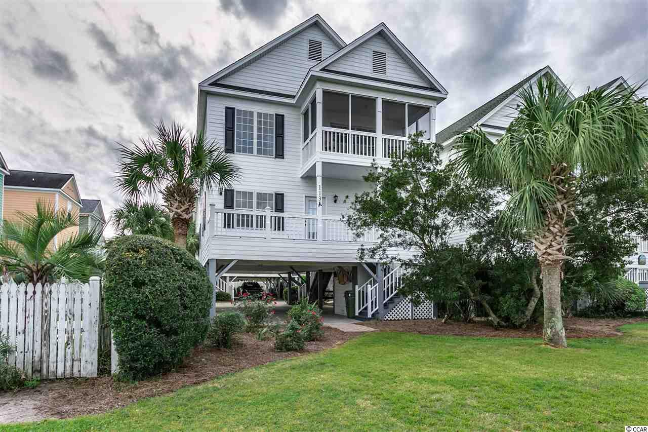 Wow! A 4 bedroom and 4 full bathroom beach house that is a block away from the beach within your budget. This Raised Beach Home is ideal place for family, and friends to stay at the beach. The home features tile flooring in the main living area. Great natural light with high ceiling in the living room. Each of the bedrooms has their own bathroom. One of the things to noticed is the storage space. There is a drop down stairs leading to the attic. Also there is a storage room located underneath the home. Enjoy two screened in porches for relaxing and hearing the ocean waves. One of the bedrooms upstairs has it's own personal balcony that has plenty of space to lay a hammock out. The owner has recently installed new carpet and paint throughout the home. You are allowed to have short term which the home has great rental income already.  The Community comes with a pool, landscaping, cable TV, pest control, two BBQ areas, and internet.