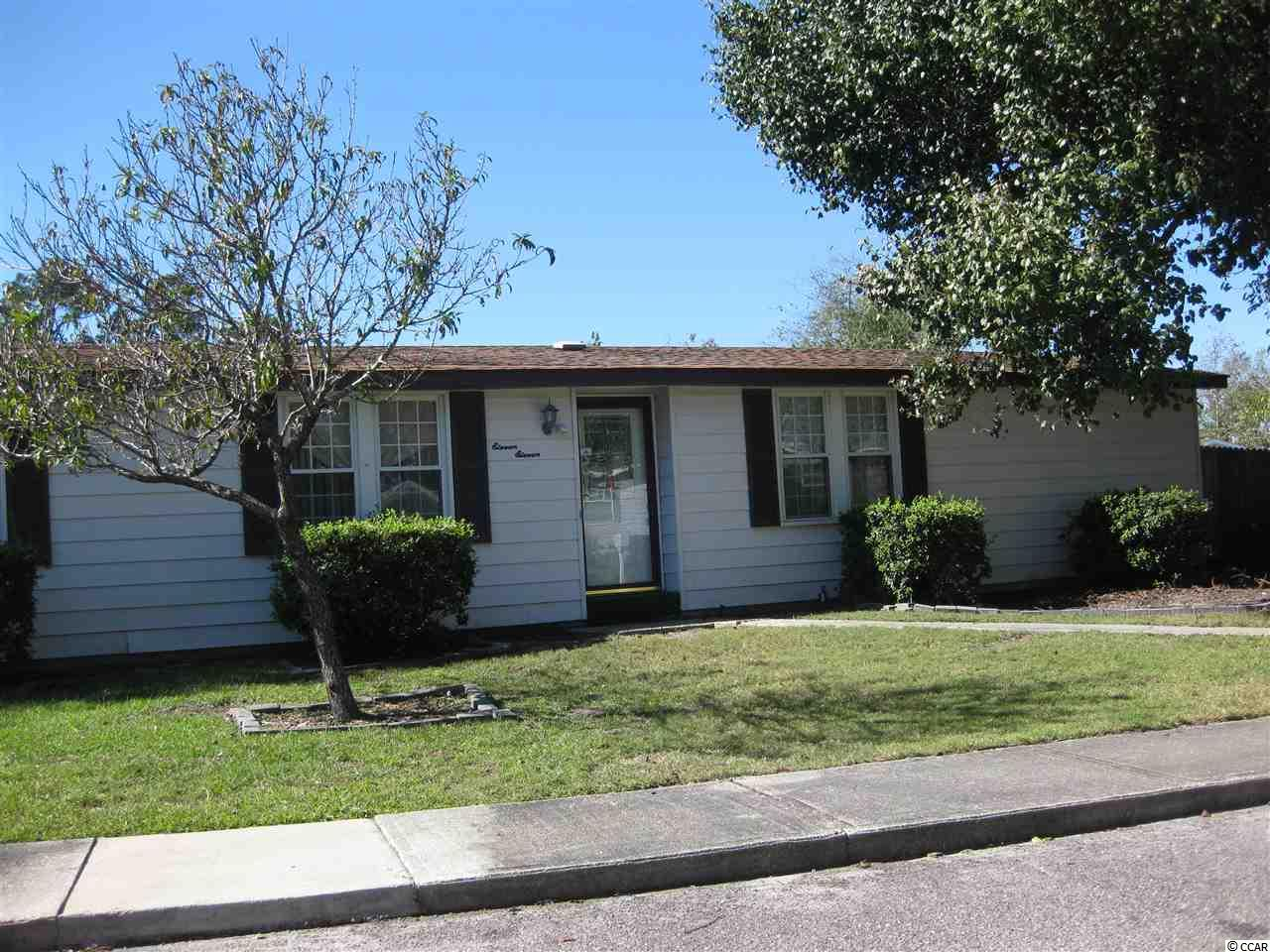 Great community just a half mile to the beach and close to all shopping and restaurants.  This 3 bedroom 2 bath home has a separate dining room, screened porch in rear and fenced in yard.  Enjoy the community club house, swimming pool and tennis courts.
