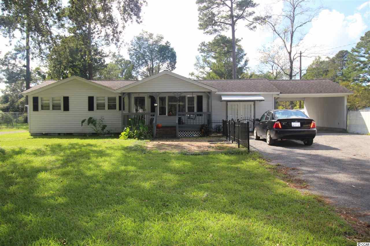 Unique offering for two homes on two parcels under live oaks. Both are currently rented but you could live in one and rent the other or continue as investment property. The main house has two bedrooms and a bath as well as a bonus Carolina room. Front porch, carport, and detached garage. Fenced in back yard. The second home lies under oaks and has 2 bedrooms and a bath.