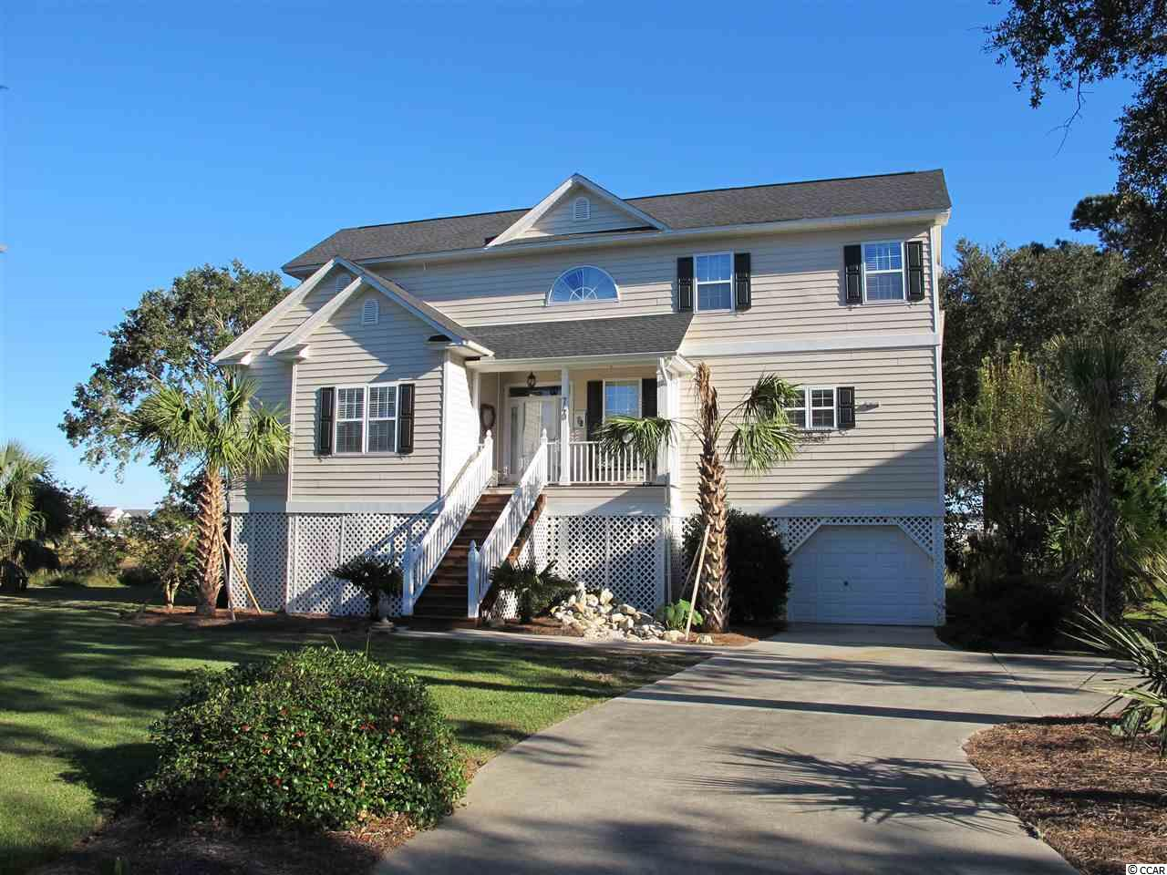 MAGNIFICENT Custom built home. Your clients will love this home and serenity yet so close to the beach.  REDUCED TO SELL !!  740 Elizabeth Drive @ SOUTH MARSH. This is a laid back and hidden treasure community located in Garden City Beach. Here you will find spanning marsh views that are spectacular day and night. Sit out on the porches and watch the wildlife and the harmony of the birds singing. Take a short golf cart ride to the beach.   This home is eloquent that flows so well. Featuring hardwood floors, plantation shutters throughout, new kitchen countertop/backsplash with premium exotic Brazillian quartzite. Recently painted & new light fixtures foyer and dining room. Outdoor shower & more features on the detail list. New landscaping with palm trees installed Sept 2018.  New roof 2016.  Home is also being sold furnished except for some antique family items that don't convey. Furniture was all purchased in 2015 and has had limited use.  See list of new upgrades and home improvements to this spectacular home.  Also featuring:  an elevator, and self contained living quarters downstairs on the ground floor with kitchen. Great for mother-in-law suite or keeping your kayaks and more.  Another feature transferable terminex bond & Rainbird irrigation system.  Experience the Marsh views will take your breath away. Oversized deck and screened porch to relax and view the beautiful sunrises and rainbow skies.  A beach & bird lovers delight.  Come see this home first on your list and you will fall in love with the home and features and community.  One more feature comes with 2016 Golf Cart for touring the beach,  shopping, and more adventures.   Home Warranty included with the purchase of the home.