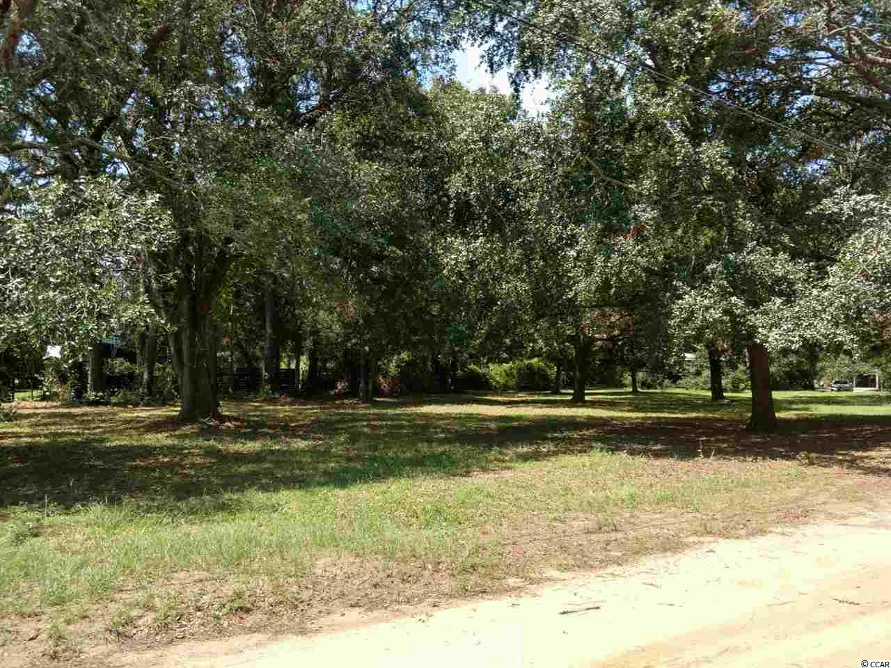 Don't miss out on one of the few lots left in Litchfield east of Hwy. 17 & your chance to view beautiful marsh views to ocean of the Hammock Coast! If you are looking for a building lot directly across from marshfront land at sought after Pawleys Island, you've found it!! One of the few remaining lots in the Litchfield Channel Bluff subdivision east of Ocean highway/Highway 17. Oversized lot with beautiful historic live oaks & scenic marsh views of Creek & Ocean. Close to fine dining,  schools , shopping, medical facilities &  public beach access at South Litchfield beaches. No HOA!! ADJACENT LOT ALSO AVAILABLE FOR PURCHASE.  An old beach community feel yet only  a 10 minute drive up to Myrtle Beach & 70 miles to Charleston. Perfect for permanent , rental or vacation home.
