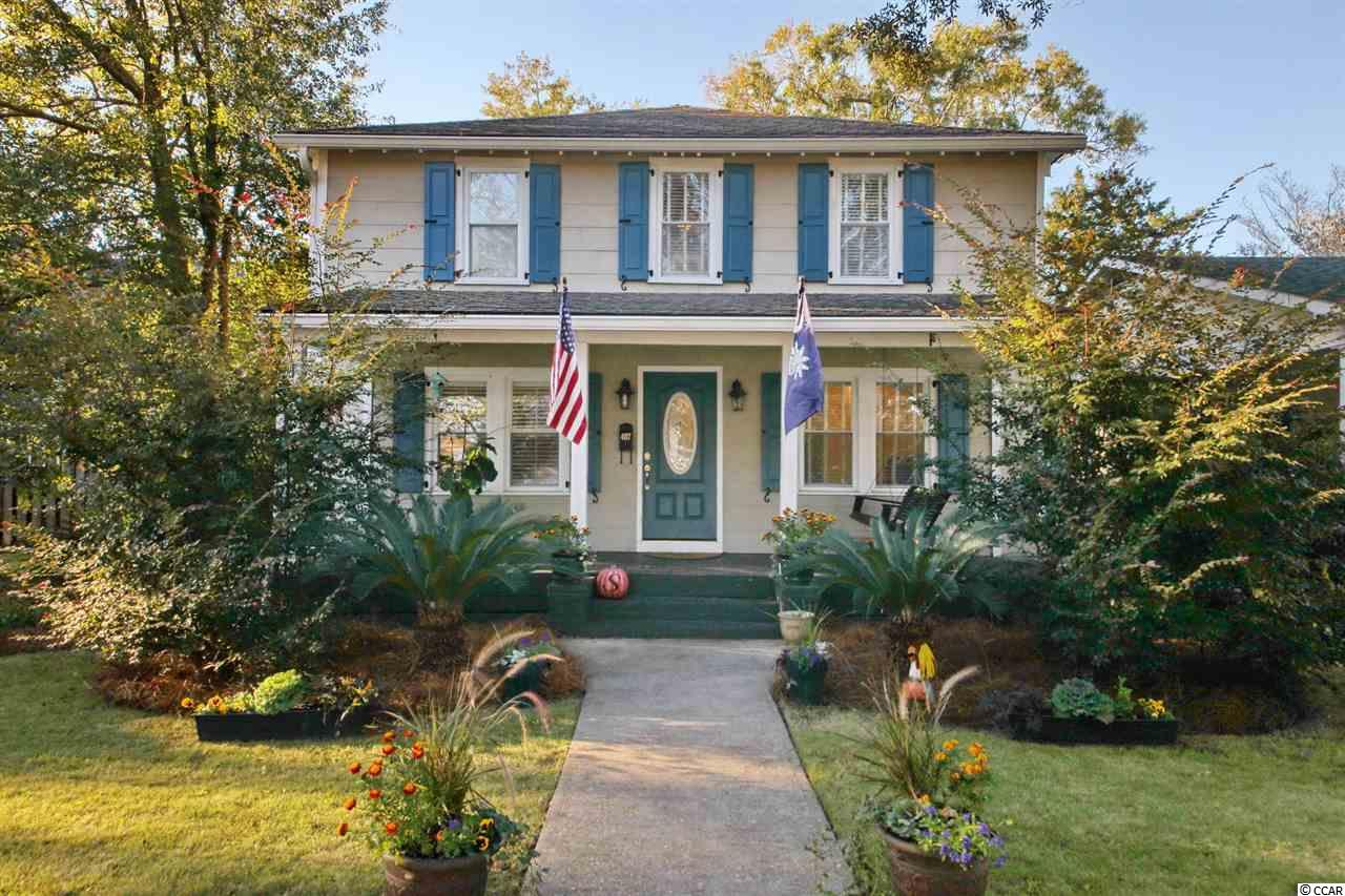 Located in charming, historic downtown Georgetown, this Lowcounty style home starts with an inviting front porch ready to your rocking chairs and swing.  Offering 3 bedrooms and 3 full baths, the interior is highlighted by wide plank heart pine floors & plantation shutters.  Upon entering, you will be greeted by the cozy family room that overlooks the formal dining area.  The open kitchen offer white cabinets and solid oak countertops.  One bedroom and one full bath also located on the first floor.  Upstairs boasts two master bedrooms that feature their own large en-suite bathrooms, walk-in closets & vaulted ceilings.  This home is centrally located to all that Georgetown has to offer.  Just blocks away from the water & the ever popular Front Street, one will find multiple marinas, public boat landing, specialty shops, restaurants & historic sites.  Come and enjoy the  quaint lifestyle of the third oldest city in South Carolina.