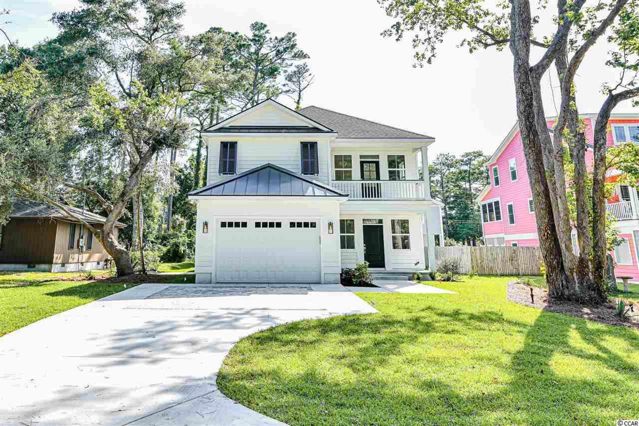 This brand new beautiful coastal cottage style home is located in Surfside Beach and steps away from the Atlantic ocean. The master bedroom, kitchen, and living room is located on the 1st floor. The open concept area will feature an island in the kitchen. The master bedroom will have trey ceilings and his and her walk-in closets. The large master bathroom will have double sinks, water closet, a deep stand alone tub, and walk in shower. The guest bedrooms have private full bathrooms along with walk in closets. The 2nd level features a study area along with a covered balcony.