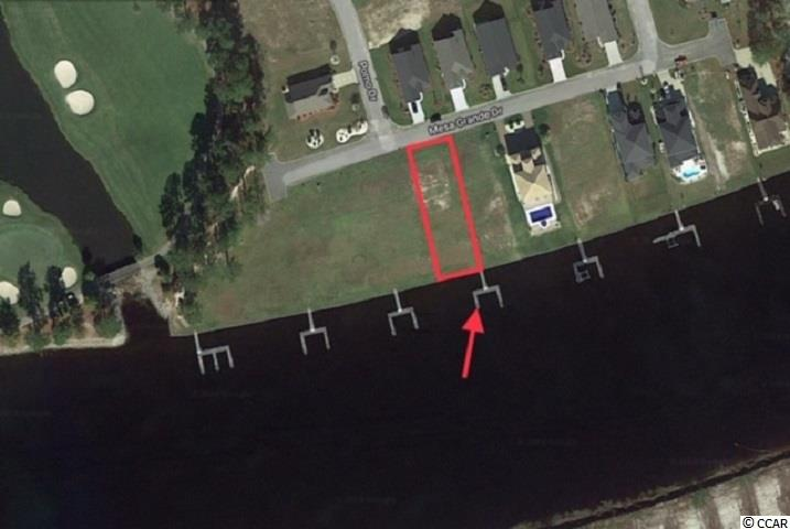Keep your boat behind your home on the Intracoastal Waterway. This lot already has its own private dock.  Arrowhead Grand is conveniently located in the Forestbrook area just a few minutes west of the Beach. This gated neighborhood borders the Waterway and Arrowhead Golf Course and feature a neighborhood pool.  The building setback area of this 60 x 200 lot is not in a flood zone and did not flood during any of the recent storm events. Bring your own builder on your own time frame, or choose one of the plans that have already been drawn to fit this lot's dimensions.
