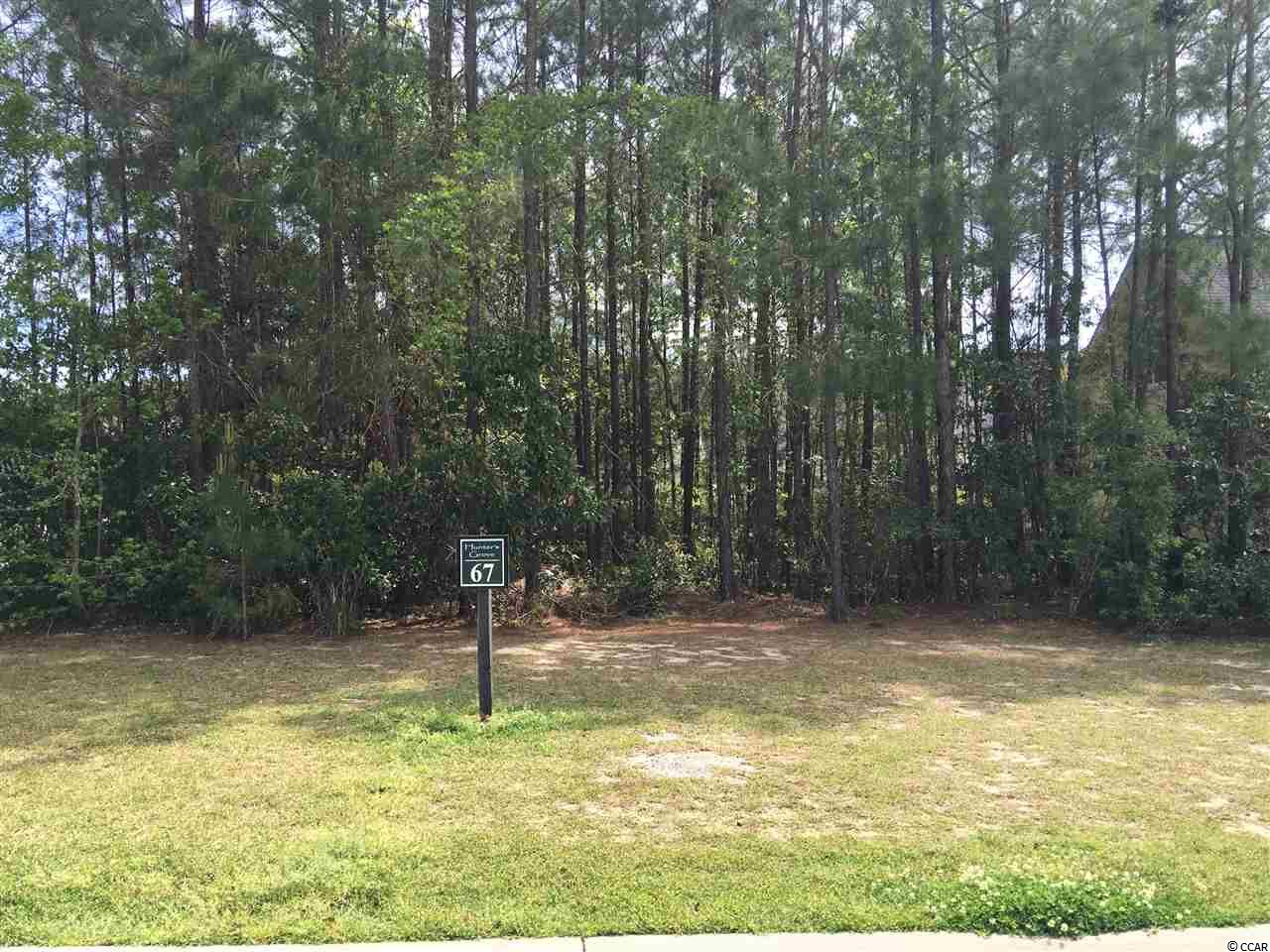 Beautiful high lot in desirable neighborhood, Hunters Grove.  Not many lots left.  Owner will sell lot, but can also build custom home.  Minutes from Marsh Walk, boat landing, shopping, restaurants and beach. Owner is a SC Licensed Real Estate Agent.