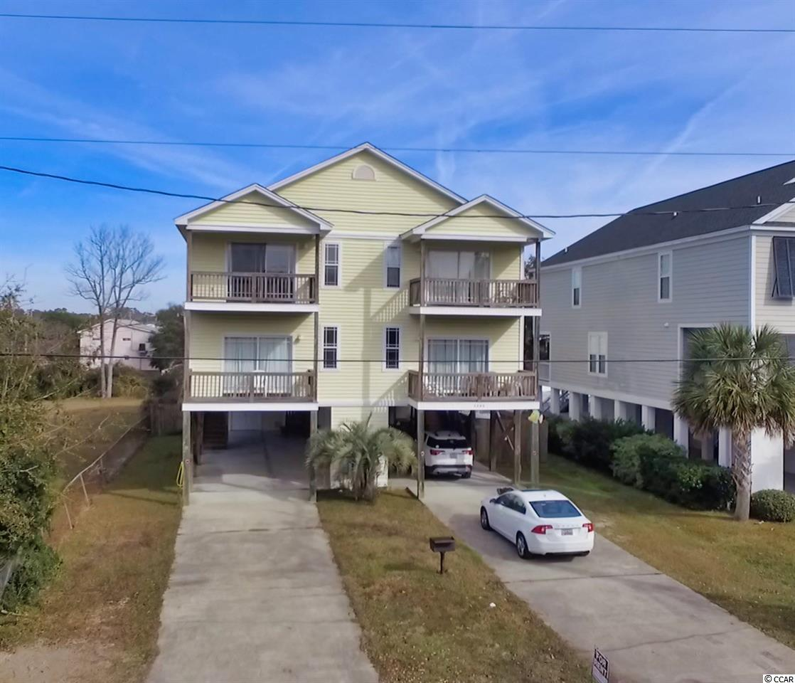 If you are in the market for a vacation house close to the beach, this is a great home to consider. 126 B Woodland Drive is the left side of a duplex, just a block from the beach. This home is ready for a new owner to put their personal touch on the interior. The entire first floor is an open floor plan with an easy flow. The family area is at the front of the home, bathed in light from the front porch windows. Next is the dining area and kitchen, complete with breakfast bar. Guest may enjoy the use of the powder room tucked away on the first floor followed by a master bedroom and bath also on the main floor. Upstairs are two guest bedrooms, two bathrooms, an additional master bedroom with bath and the laundry closet. This house features two balconies and a back porch over looking the pool. Located close to shopping golf and most importantly an easy walk to the beach! The close public beach access offers plenty of parking. 126 B Woodland Drive is priced well and is ready for its new owners!