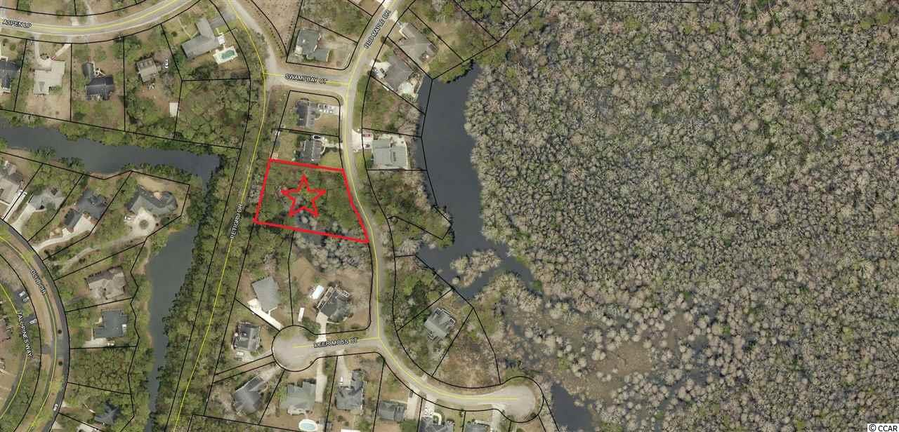 Rare opportunity to own a spacious building lot in one of the more sought after areas in Pawleys Island, SC. Boasting well over a half an acre, this prime building parcel offers public water/sewer and boasts NO HOA. Red Maple Drive is located approximately 1 mile to public beach access and is only a few minutes from public boat access to the Intracoastal Waterway. In addition, this property offers direct access to miles of paved biking / walking trails and is nearby public recreation.