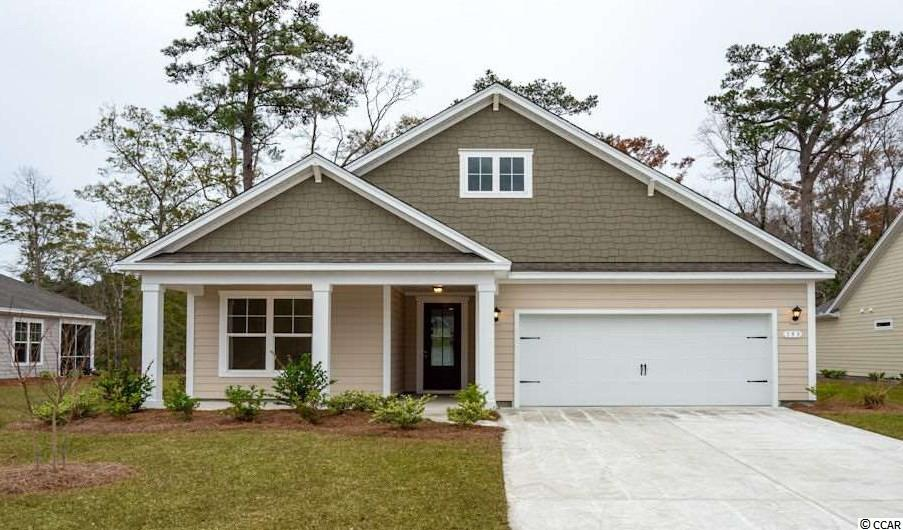 """Hammock Cove is the place you want to call home! This quaint community offering 88 homesites with private or pond views, conveniently tucked away in the heart of """"Arrogantly Shabby"""" Pawleys Island. Just moments away from beaches, marinas, dining, golf courses, shopping, and hospitals. If you are interested in downsizing, up-sizing, or if you would like to add a pool and create your own outdoor living space, Hammock Cove has the homesite and home for you. We offer both single-story and two-story, thoughtfully designed, open living floor plans. Perfect for entertaining family and friends or just creating the perfect space for your daily needs. The Litchfield is one of our most desirable single-story homes. This 4 bedroom, 2 bath, offers high ceilings and open living area. This home also includes upgrades including but not limited to; granite counters, tile backsplash, gourmet island, and pantry. It also includes crown molding, 5 1/4"""" baseboard, and 8ft. entry door. This open floor plan is perfect for entertaining friends and family. Owners suite and bath offers a spacious walk-in closet, tile shower, and double vanities. This home is a must see. Call Eryn to schedule your appointment today!  Home and community information, including pricing, included features, terms, availability and amenities, are subject to change and prior sale at any time without notice or obligation. Square footage is approximate. Pictures, photographs, colors, features, and sizes are for illustration purposes only and will vary from the homes as built.  Equal housing opportunity builder."""