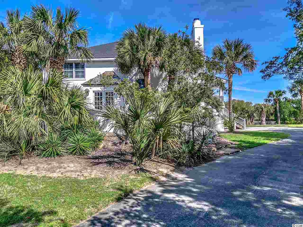 Private 5 bedroom, 3 bath home with a great family feel on the canal and a block from the beach. This home features open living/dining room, wood burning fireplace, downstairs den/game room with both screened and open porches. There is a crabbing dock on the canal, an outside shower and plenty of storage space for all of your beach toys. DeBordieu Colony is a very private, oceanfront gated community located near Pawleys Island, South Carolina on the coast between Charleston and Myrtle Beach.