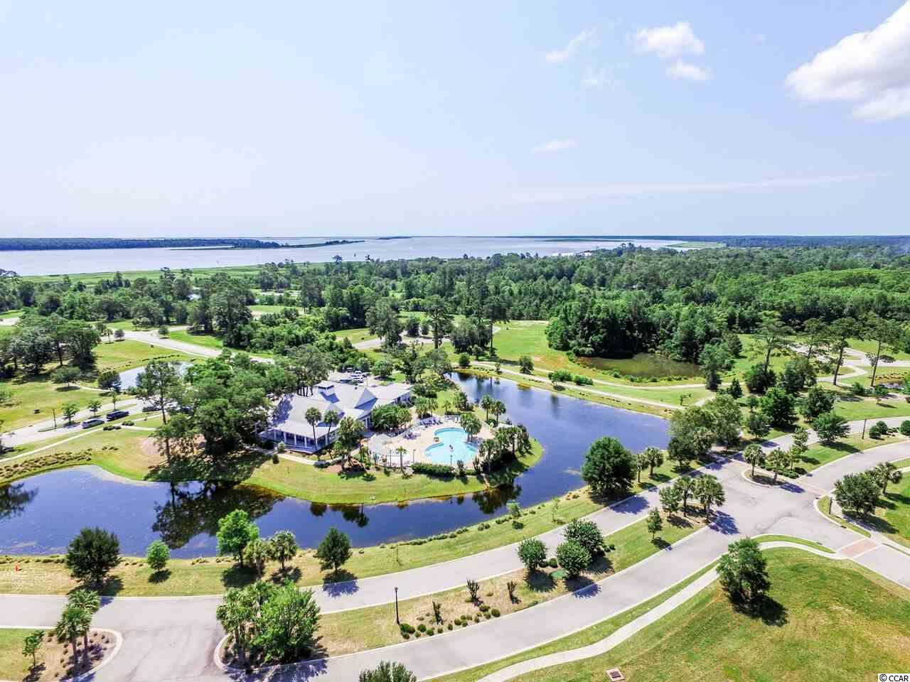 Located in South Island Plantation, a gated community located along Winyah Bay and the Intracoastal Waterway, near Historic Georgetown, SC. Community amenities include a pool, kiddie pool and hot tub. There is also a 5000 sq ft club house with an equipped fitness center, a bar and a full kitchen. Walking trails wind throughout the community with gazebos for periodic resting. A fishing/crabbin' gazebo is now complete. A secured RV/ Boat storage area is available for property owners. Beautiful ponds for fishing and huge Oak Trees make this one of the premier communities in the Georgetown area. Natural gas is also available in South Island Plantation. Build your dream home today..