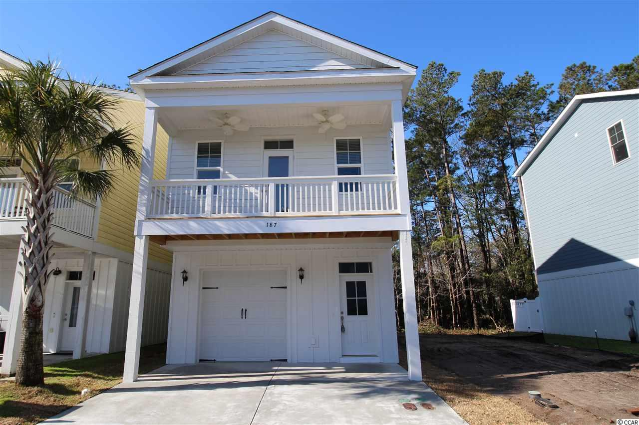 """MOVE IN READY!   Located 1 Mile From The Beach! Ideal Primary Home or Beach Getaway!  Enjoy Easy Living At Jamestowne Landing, Which Has An HOA That Manages The Homeowners Insurance, Exterior Maintenance, Trash Pickup, Cable TV, pest control, Lawncare/Landscaping, & Community Pool Which Is Only Steps Away. GOLF CART TO THE BEACH Straight Down Jamestown Rd/Atlantic Ave To Multiple Garden City Beach Access Points. Enjoy All The Garden City Beach Restaurants, Garden City Pier, Arcade & Shops. Restaurants & Shops Are Within Walking Distance Of Community As Well.  The """"SEABREEZE"""" Model Offers 3 Bedrooms, 3 Full Baths, Over 1900+ Heated Sq. Ft... PLUS A Bonus Room with Full Bath On 1st Level, Which Would Make A Great Guest Room or Mother-In-Law Suite. High Quality Luxury Vinyl Plank Flooring in Living Area and Bonus Room on Ground Floor. Pocket Door between Master BR and Bath. 42"""" Solid Wood Cabinetry in Kitchen w/Soft Close Doors and drawers, Granite Tops, SS Appliances.  Deep One-Car Attached Garage & 2 Car Parking Pad Plus Shared Parking Throughout Community.  Plenty of Room for your Toys, Including a Small Boat. Sturdy 2x6 Construction Gives you Piece of Mind. The Inviting Front Porch Has Overhang & 2 Paddle Fans...All You Need Is Your Glass of Iced Tea!  Lot 403 Backs Up To Wooded Area.   We are Here To Help!  Other Floor Plans (from 1500-2000 S/F) & Upgrade Options Are Available To Customize Your Home.  Pictures Are Of The Actual Home. Sq. Ft. Is Approximate And Not Guaranteed, Buyer To Verify."""