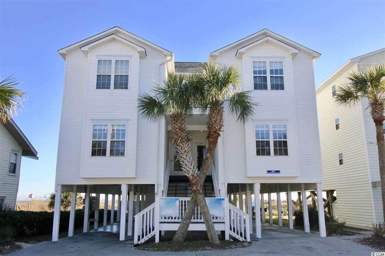 This Oceanfront Home is located in the heart of North Myrtle Beach! Loaded with features this 10 Bedroom home layout is two 5 Bedroom, 5 1/2 Bath units. Truly a great investment and personal vacation property. The home is fully furnished, new paint, features crown moulding, chair railing, and has amazing beach views! Inside the home each 5 bedroom side enjoys a large kitchen with dual refrigerators, granite counters, bright recessed lights, ceiling fans, and more. The dining room is oversized and large living room ensures space for all. The Master Suite bedroom design includes a roomy Oceanfront Deck. All bedrooms have TV's and beds sizes range from King, Queen, Bunk and even Day Beds for a comfortable nights rest. The property also features a  onsite game room with kitchenette, swimming pool and deck, as well as grilling area. This is a great Oceanfront property opportunity in North Myrtle Beach.
