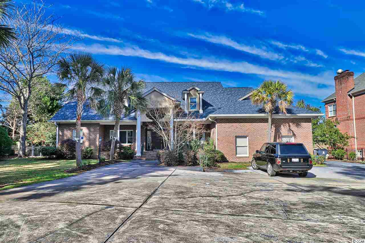 Direct Intracoastal Waterway Dream Estate located in the Prime of Myrtle Beach SC. This Elegant 5-Bedroom & 3-Full Bath,3 half bath home has a Commanding View of the Waterway from Inside the home as well as the Custom Pool and Spa deck area, and not to miss the Massive Entertaining Dock and decks on the Waterway all ready for your boats,jet skis,kayaks and fun water toys. Inside the home all rooms are spacious with hardwood floors,tile and carpet. All bedrooms have a view of the Waterway. Fireplace In the living room, lots of kitchen cabinets,granite countertops,pantry and eating area. Office with builtins and pocket door. Rec room level with ground floor from the back of the home with sliding doors for entertaining. The property has privacy and mature landscaping.