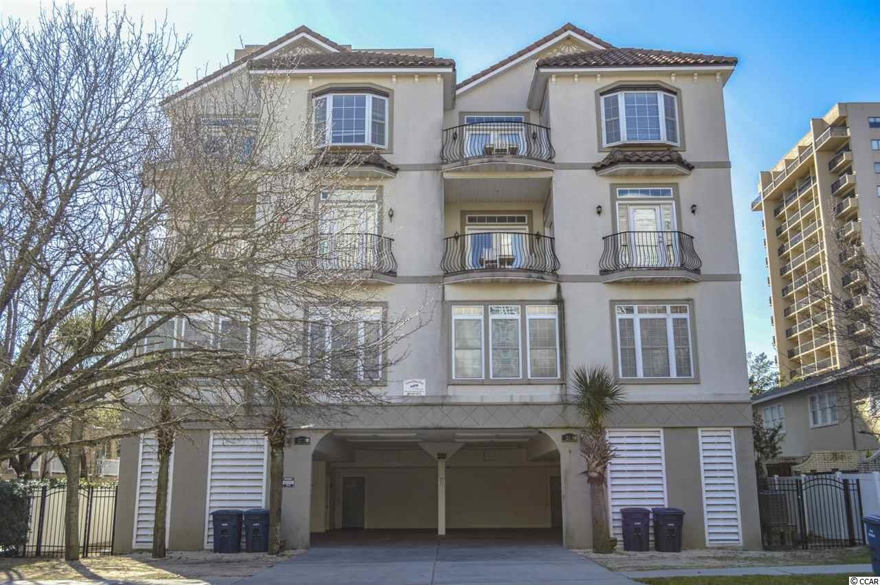 INVESTOR SPECIAL with strong rental history - Perfect for 1031 Exchanges. 4000+ square foot 8 bedroom and 7.5 bathroom, three-floor villa with interior and balcony views of the ocean on all three floors (sleeps 16-20). Situated in a quieter, upscale, northern section of Myrtle Beach amid private dwellings. 125 YARDS TO THE BEACH. Perfect location for accessing the entertainment and amenities of both Myrtle Beach and North Myrtle Beach. Close to an abundance of shopping and dining options - perfect for family vacations, golf retreats, sport teams, etc. Covered under building private parking for 4-5 cars (depending on size), private egress, fenced and tree surrounded patio. Common area includes a shared outdoor pool and large hot tub. PRIVATE ELEVATOR access from garage to all floors. First floor features 3 bedrooms, 3 bathrooms, recreational room with pool table, and full kitchen with stainless steel appliances and granite countertops. Second floor has 2 bedrooms (including luxury master bedroom), 1.5 bathrooms (includes master bathroom with ceramic tiled walk-in shower, whirlpool tub, and dual raised sink bowl vanities), large living room, and dining room area. Second floor is also equipped with an oversized gourmet kitchen featuring granite countertops, stainless steel appliances, work island with raised sink bowl, wine cooler, and pantry. Third floor has 3 bedrooms, 3 bathrooms, laundry room (with full size washer/dryer) and living room complete with wet bar. This property must be seen to be appreciated - lots of upgrades like crown molding, tray ceilings, recessed lighting, ceramic tile & wood flooring throughout! Perfect property for a 1031 exchange. Priced to sell and will not last long, don't miss your chance before it's too late!