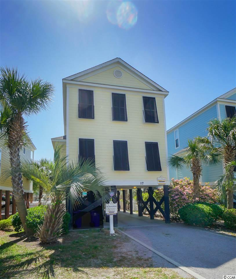 This 4-bedroom, 4-bathroom raised style beach home is just a short block away from the beautiful Surfside Beach and Atlantic Ocean.  Convenient location in the heart of Surfside for easy walking access to restaurants, shopping and more.  Just updated with new flooring and brand new granite counter tops!  Large open kitchen/dining/living area layout that is ideal for large gatherings.  Pool side master suite and pool side double covered porches.  Private 18' x 12' pool within a fenced-in backyard.  This house is completely set up for summer vacations and a great rental investment!  Being sold fully furnished, rental ready.