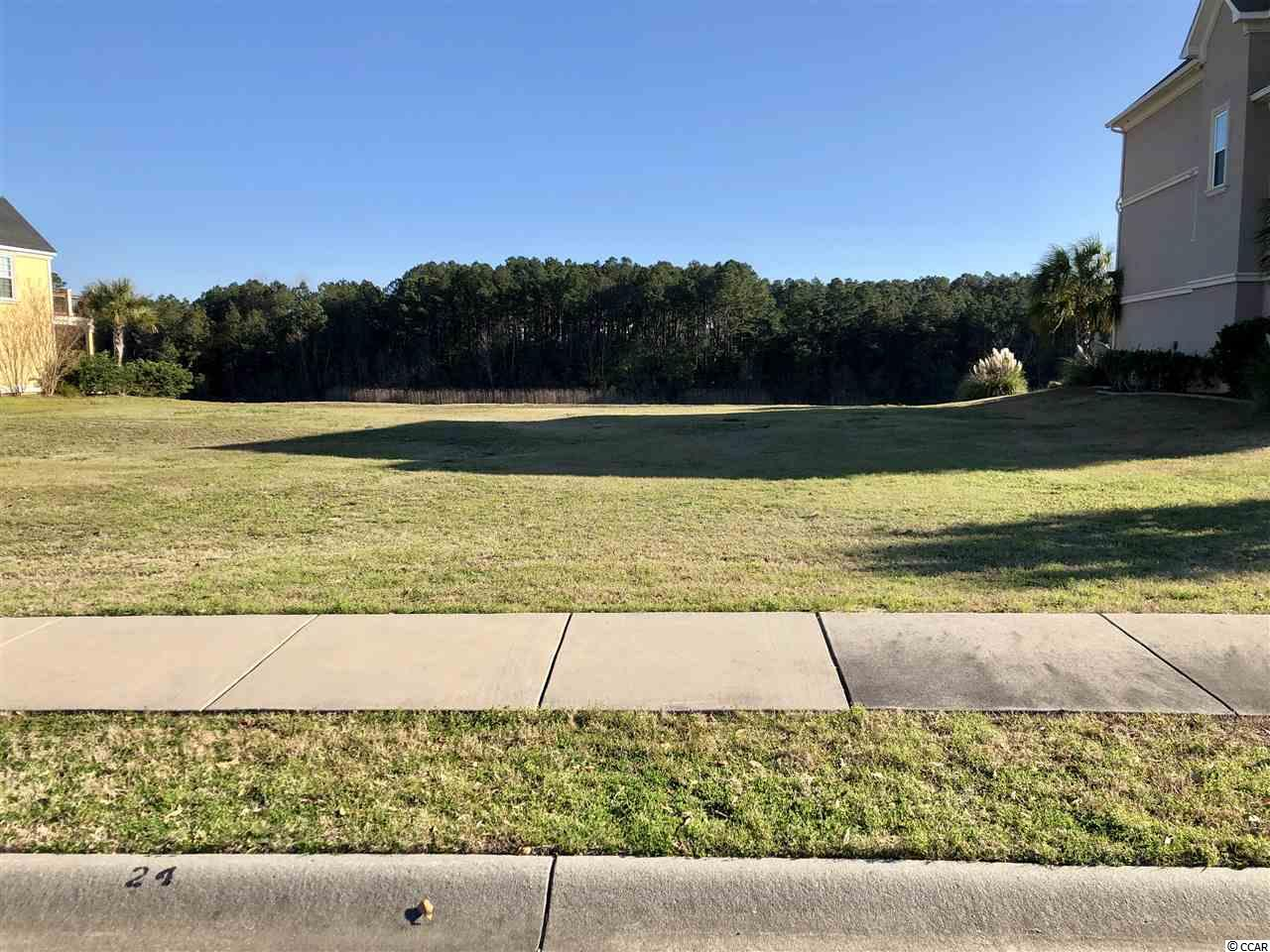Stunning water front property on the Intracoastal waterway. Located in the prestigious and highly desired Carolina Forest community of The Bluffs on the Waterway, this lot leavings nothing to be desired. Boasting approximately a third of an acre of cleared land, this lot is awaiting your dream home. The Bluffs community offers some of the finest amenities you'll find along the grand strand including but not limited to; gated community, boat launcher, floating dock, boat storage, tennis courts, pool, two clubhouses, and playground. Conveniently located near grocery stores,  Coastal Grand mall, numerous golf courses, and of course the beach! All measurements are approximate, buyer must verify.