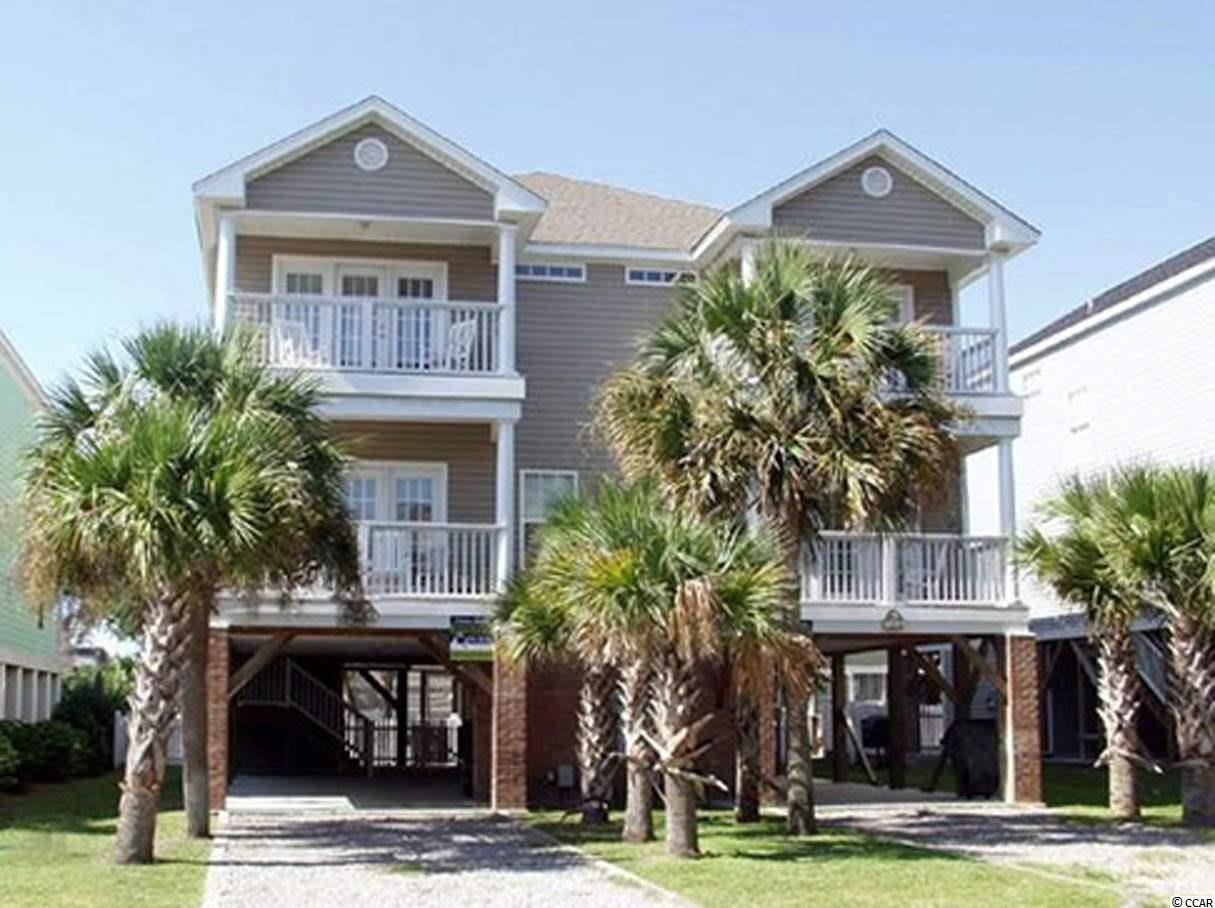 This first block, ocean view duplex unit has a private pool, five bedrooms/4.5 bathrooms, and no HOA!!!  Located in the preferred northern section of Surfside Beach, this beach home is steps away from the beach yet tucked away on 13th Ave. North to avoid Ocean Blvd. noise and traffic.  The owners of this lovely duplex have taken exceptional care of this unit while recently installing new flooring throughout the upstairs and downstairs, new HVAC units, new granite counter tops and stainless steel appliances all within the last two-three years. It has three covered decks to maximize outdoor living and has great ocean views from the front.  This home is sold fully furnished and has wonderful rental history with multiple repeat renters for many years.  Call the listing agent, or your Realtor, to schedule a showing or for additional information!