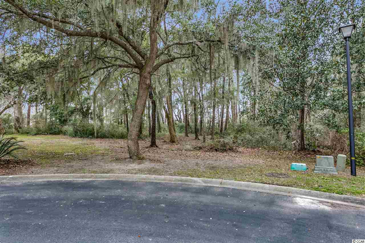 Fantastic opportunity to own this lot located in the prestigious southern charm community of Heritage Plantation. This gorgeous lot is framed by Magnolia trees, stately Oaks, spanish moss and private lush greenery tucked away in your private own cul-de-sac. This lots best feature once you build is a fantastic and unobstructed view of the Marsh and Intercoastal waterway! Sit and watch the boats go by as you sip your coffee knowing nothing will be built between you and the waterway! Also by owning this lot, it is at the end as well as you're surrounding by wetlands and marsh meaning no one will build to the right of you. Heritage Plantation amenities abound in this Intracoastal Waterway community includes a marina, dock master, owner's clubhouse, clay tennis courts, pool, pergola and spa located at the pool, party deck and dock house and various golf club and golf packages at the Heritage Golf Club. Build your estate dream home and enjoy the peaceful living of Pawleys Island. No timeframe to build. Heritage Plantation is a short drive to all your area entertainment, shopping, dining, and the well known Murrells Inlet Marshwalk.