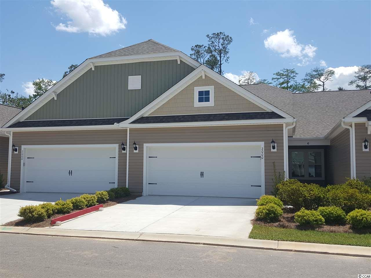 Move In Ready. Spacious Garden Homes in Palm Lakes consist of 70 villas; 4 single level living per building. This Edisto is an interior villa 3BR/2BA, 2 car garage and attic storage. Other features include granite, SS appliances, EVP flooring in main living areas, carpet in bedroom and tile in bathrooms. Tiled shower in owners bath, tray ceilings, natural gas fireplace, window blinds and screened porch to enjoy the private back yard tree line view. If you are looking for a maintenance free lifestyle and not having to hassle with exterior upkeep and lawn care then stop by Palm Lakes Garden Homes for a view. Amenity Area with Pool, Club House, Fitness Room and Playground. A quick 10 minute drive to the beach, shopping, restaurants and medical centers and only 5 minutes to the North Myrtle Beach Sports Complex.