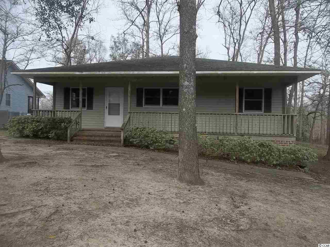 This house is on a HIGH lot that never floods, it overlooks Yauhannah Lake.  It  is right next to the boat landing.  It is on the lake so boat traffic is not a problem.  It has 4 bedrooms and 2 baths, a jenn-air range in the kitchen, fireplace, 12x40 screen porch on the rear overlooking the lake.  It is a sportsmans paradise, it has 170 feet on Yauhannah Lake.