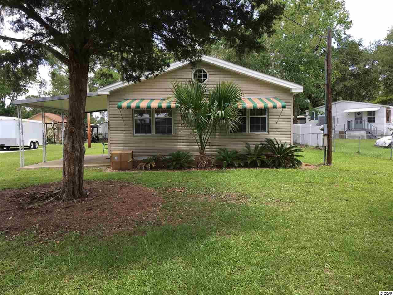 3 bedroom 2 bath mobile home with extra large lot measuring 75x174. Short walk to the beach. Large public access with parking for cars and golf carts. Home has been remodeled with new flooring, freshly painted, and has furniture and appliances that will convey making it move in ready. Enjoy what Garden City has to offer by owning a home of your own. Rentals are allowed in the area.