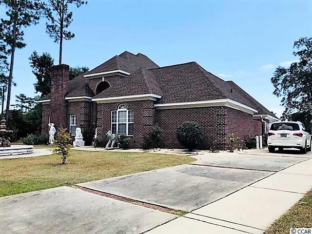 Almost everything has been upgraded. Tiles, marbles and hardwood floors through out the house. 630 sqft bonus room upstairs, 725 sqft entertainment room. Brand new roof and new crown molding around exterior of the house. Golf course view in the back yard. This is a unique house plan located in Coastal Heights walking distance to Coastal Carolina. House is located directly on the golf course with wide view, cover porch with lots of shade, large kitchen. Home even has a secluded courtyard nested in the midst of the exterior, really large bonus room up stairs. The large fountain in the front of the house to the simi circular stairwell in the over size foyer. Must see this house and make it your dream house.