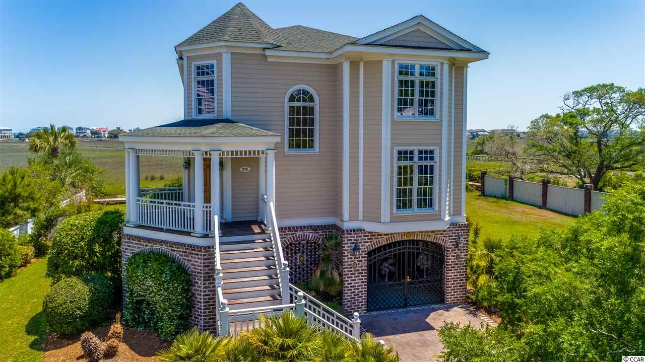 Tremendous price reduction! What a deal! What a view!  Located in the heart of Pawleys Island on the salt marsh. Oak Lea is a quaint Charleston style gated community with a community pool that overlooks the marsh, has a floating dock, and a tennis court. This home boosts spectacular marsh and ocean views. A custom built 4 bedroom, 3 bath home that pays attention to detail. There are heart pine floors, cabinets, and columns. You will find marble in the bathrooms and ornamental tiles and granite counter tops in kitchen. Custom natural finished blinds throughout the home. The adjustable semi-circle blinds are handmade. Entire home has beautiful crown molding that portrays the quality on the home. Master suite has amazing views of the salt marsh and ocean from all windows. In addition, the master suite has a separate sitting area with a arched entrance as well as the beautiful wood columns. A spacious laundry room and plenty of closets and storage space available. Irrigation system. A new roof was installed in 2017. The large back deck with plenty of room for entertaining was recently replaced with synthetic boards and Ipe stairs on the front of the house. The front driveway is done with pavers that leads up to a beautiful wrought iron palm tree gate to access your parking underneath the home. There is also an outdoor covered sitting area under the house looking into the back yard and beyond to the marsh as you relax with family and friends. Plenty of space to store all your beach toys under the house. Marsh and ocean views from living and kitchen areas as well as from the master suite upstairs. Come enjoy sunrises and sunsets from this home every day!!!