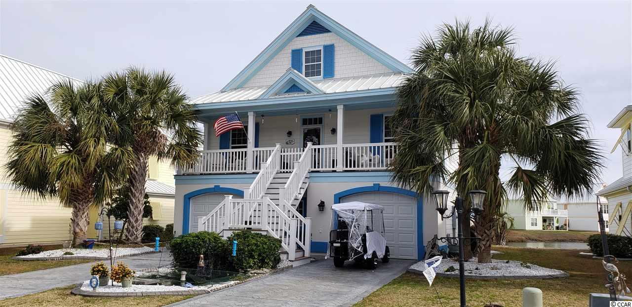 Beautifully maintained home with custom upgrades both inside and out is now available!  An award winning home design located in the beach front community of Bermuda Bay is now available on a premium lot location overlooking one of the main water features.  Offering 5 bedrooms,  4 1/2 baths, this home lay-out is like no other with 2  separate and distinct living areas, the guest area with a full kitchen, living and sleeping areas on the lowest level that is in addition to the two main levels of living space of the main home.  Community Amenities include 24 hour gated/patrolled security, private beach parking access, indoor heated & an outdoor pool complex featuring a splash park and two covered areas, a 9000 square foot Community Center for planned activities, a separate activities & fitness center ($), Library, Lighted Tennis, Pickle Ball, Basket & Soft Ball Fields and so much more. While the current (original) owners have lived in the home full time during their ownership, Bermuda Bay allows both weekly and off season rentals in one of the only Residential Resort Communities on the southern Grand Strand!