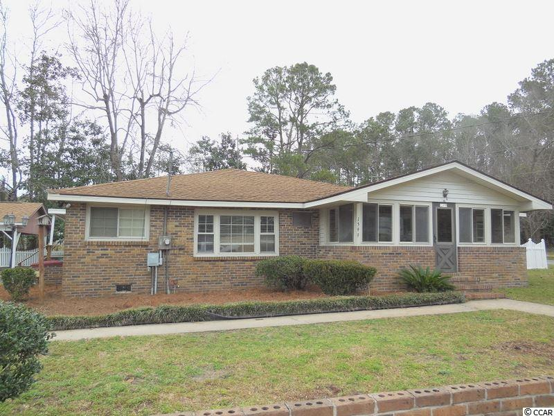 This all brick home has a enclosed front porch and a Carolina Room overlooking a large back yard.  NO HOA !  PLENTY OF ROOM FOR RV AND BOAT PARKING!  A large 2 car carport, one car garage and expansive workshop.  This is a large corner lot and is zoned commercial/residential and one block from waterway on the corner of Mineola and Watson in the older section of Little River . A short walk from the boats, restaurants and benefits of the Little River Area.   Perfect for a home or a business!