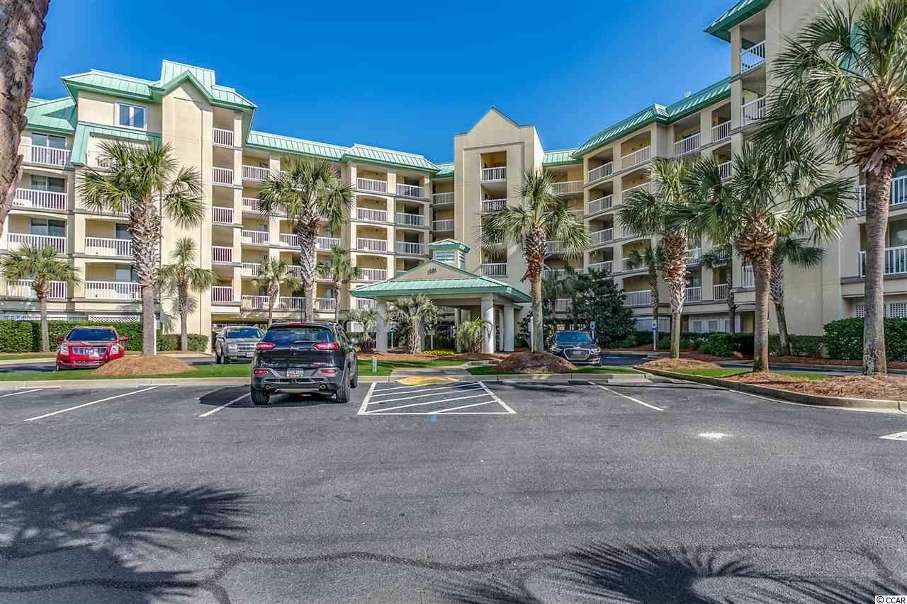 """This is your chance to own a very spacious 2 bedroom, 2 bath oceanfront """"end unit"""" in the highly desirable gated community of Cambridge at Litchfield By The Sea . This unit features a very open floor plan with tiled floors throughout. Top of the line furniture, a separate laundry room with washer and dryer are also included. The kitchen opens up to the living room and dining room with a breakfast bar that seats four. Master bedroom has it's own bay that goes out to the balcony. Master-bath features a double sink, garden tub, and separate shower. The Cambridge is second to none with many amenities that include swimming pools, tennis courts, and walking and biking trails. Don't miss this opportunity to enjoy oceanfront living!"""