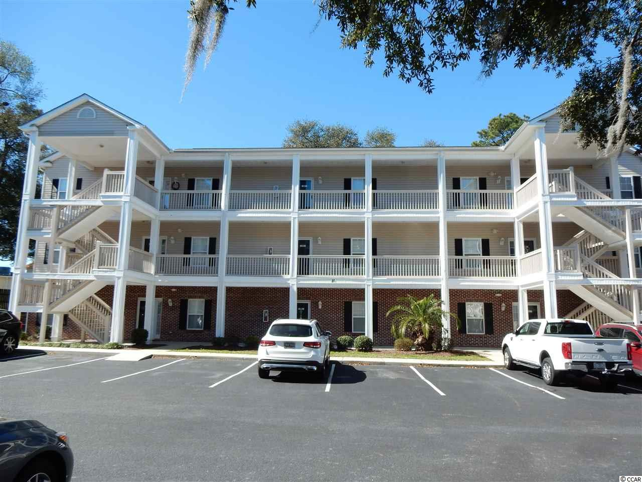 Spacious 3 bedroom 2 bath unit with lots of closet space.Top floor corner unit. Beautifully decorated & furnished - in excellent condition. Large oversized screened in back deck.Only a  golf cart ride to the beach & shopping.