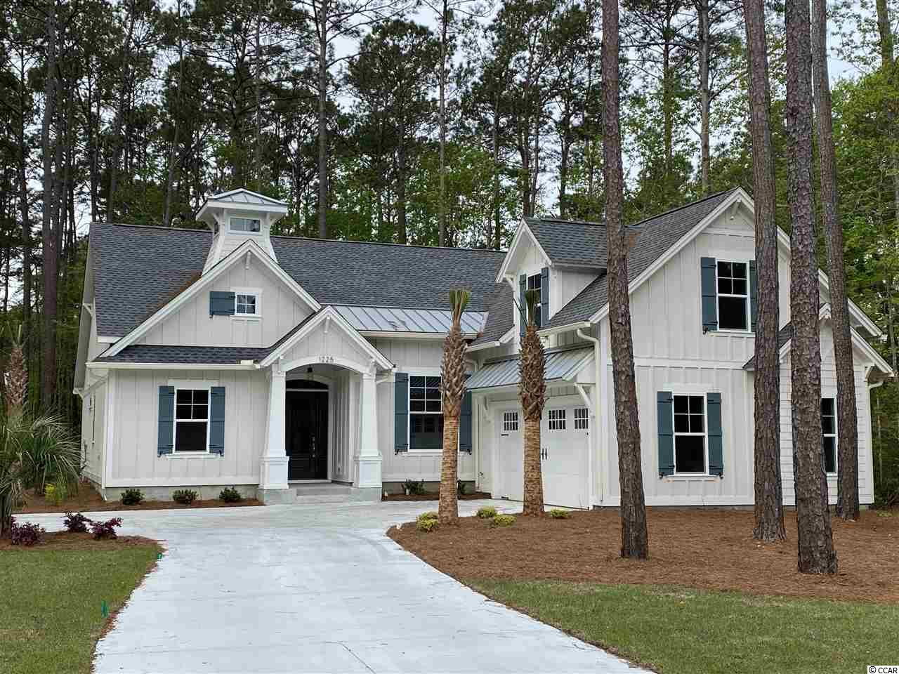 Welcome to BEAUMONT PARK in Pawleys Island!  New development just minutes from the beach, restaurants, grocery stores and more. One acre home site with NO HOA. Nations Homes is the custom builder. This home is under construction and to be an estimated 2576 heated square foot home. Contemporary craftsman style 4 bedroom, 4 bath home with Hardie plank, shake, board & batten siding along with brick accenting exterior.  Two car attached garage. A bonus room is the 4th  bedroom and has its own bath and walk in closet plus additional attic storage. A beautiful 16 x 12 covered veranda to enjoy your morning coffee or afternoon cocktail with friends. Covered veranda can be screened. This is an optional upgrade. An open floor plan with a large great room, dining and breakfast nook. 14 x 19 Master suite and master bath with double vanities, tub,  tile shower and walk in closet. Beautiful interior with crown molding, tile floors throughout main living area, granite counter tops, and custom cabinets. Come see this beautiful home and start living the Pawleys Island lifestyle! Pictures are of model home in another community. Some features may vary. Home to be completed October 2019. Disclaimer: Storm water plan may change to gain use of undisturbed area at the back of each lot.